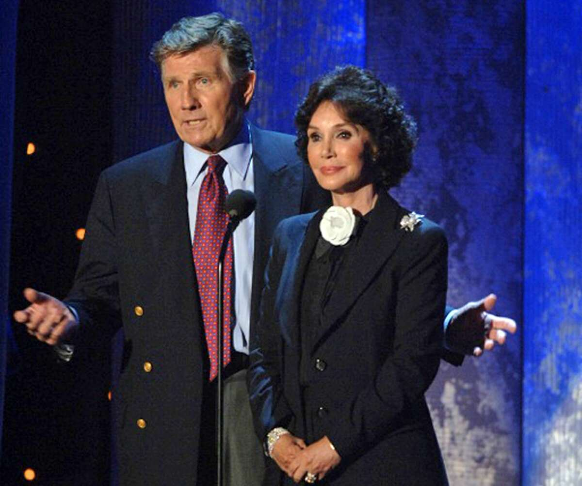 This Oct. 1, 2005 photo provided by the University of Mississippi Communications shows Mary Ann Mobley, right, and husband Gary Collins, at the charity event Mississippi Rising, a fundraiser for Hurricane Katrina relief, held at Tad Smith Coliseum at the University of Mississippi in Oxford, Miss. The former Miss America who went on to appear in movies with Elvis Presley and make documentary films around the world has died. A spokesman for the University of Mississippi confirmed that Mary Ann Mobley Collins died Tuesday, Dec. 9, 2014, in Beverly Hills, Calif. She was 75. (AP Photo/University of Mississippi Communications)