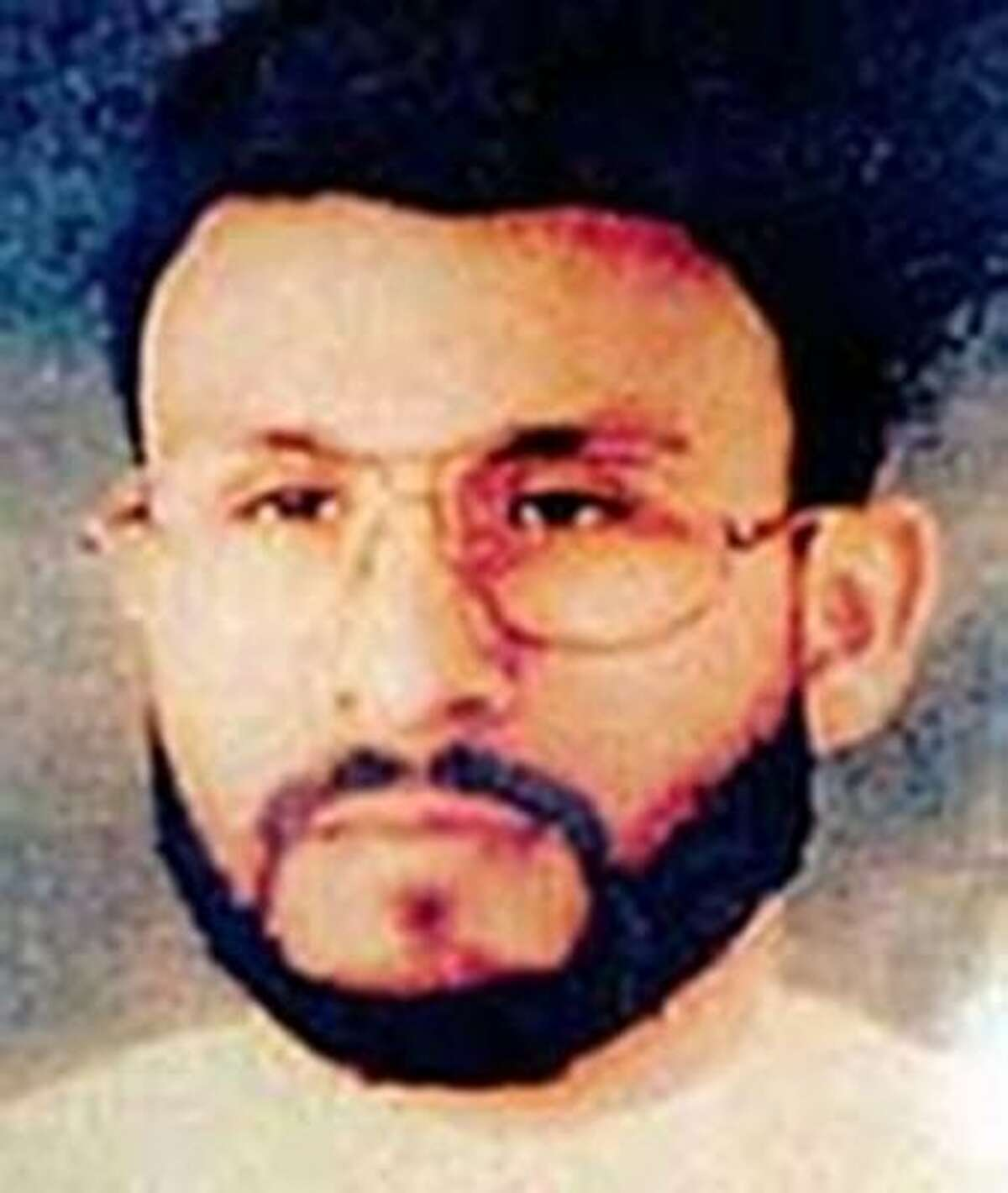 FILE - This undated file photo provided by U.S. Central Command, shows Abu Zubaydah, date and location unknown. Zubaydah was the CIAís guinea pig. He was the first high-profile al Qaida terror suspect captured after the Sept. 11 attacks and the first to vanish into the spy agencyís secret prisons, the first subjected to grinding white noise and sleep deprivation tactics and the first to gasp under the simulated drowning of waterboarding. Zubaydahís stark ordeal became the CIAís blueprint for the brutal treatment of terror suspects, according to the Senate Intelligence Committeeís report released Tuesday. (AP Photo/U.S. Central Command, File)