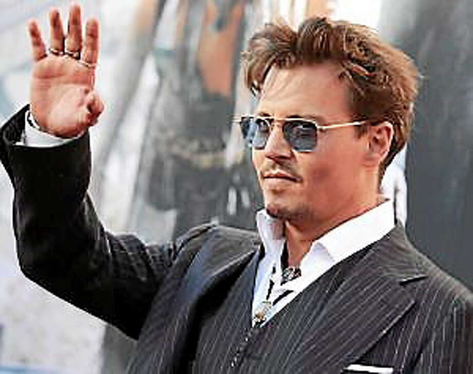 """In this Saturday, June 22, 2013 photo, actor Johnny Depp arrives at the world premiere of """"The Lone Ranger"""" at Disney California Adventure, in Anaheim, Calif. Photo: (Dan Steinberg — Invision) / AP2013"""