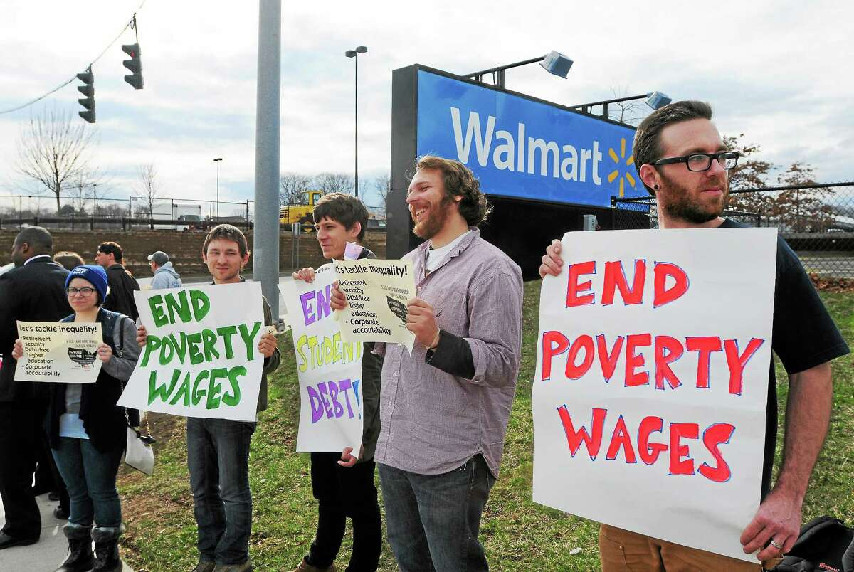Supporters and members of the Working Families Party, Fast Forward and other progressive groups and individuals demonstrate in front of Walmart in West Haven in this file photo to bring attention to their belief that there is a growing divide between rich and poor in Connecticut.