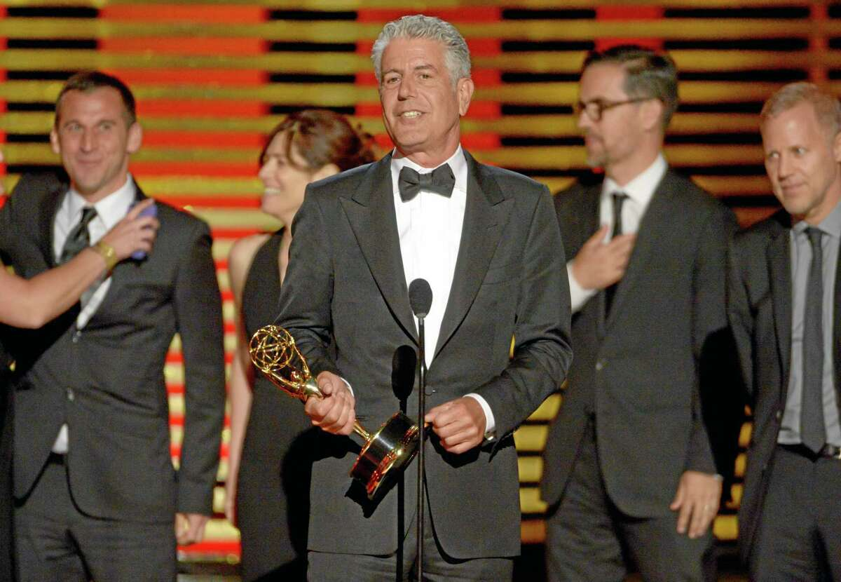 """Anthony Bourdain and the team of """"Anthony Bourdain: Parts Unknown"""" accept the award for outstanding informational series or special at the Television Academy's Creative Arts Emmy Awards at the Nokia Theater L.A. LIVE on Saturday, Aug. 16, 2014, in Los Angeles."""