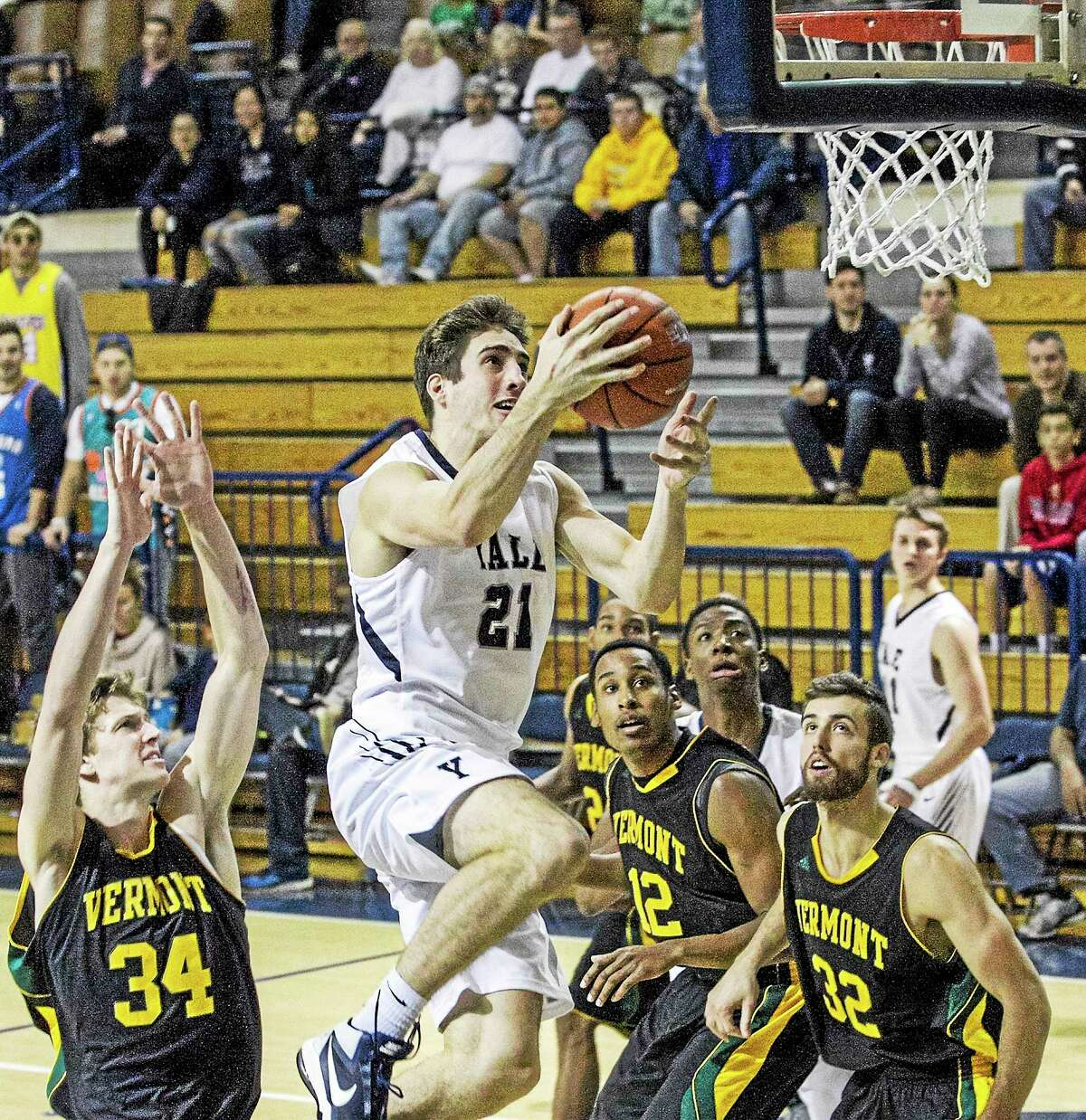 Yale's Nick Victor goes up for a layup during Saturday's game against Vermont.