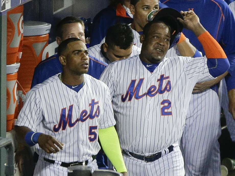 Yoenis Cespedes, left, has found Citi Field to be to his liking. Photo: The Associated Press File Photo  / AP