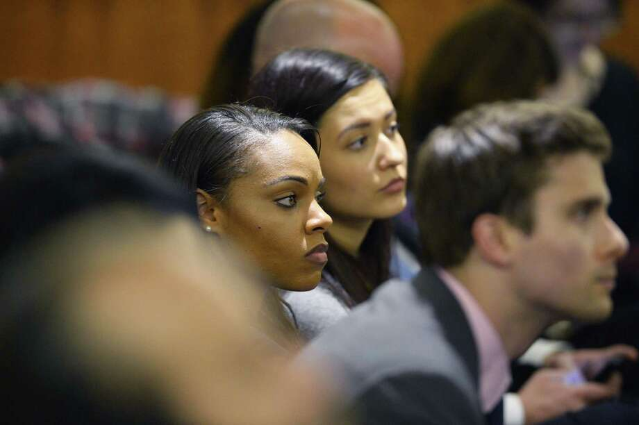 Shayanna Jenkins, center, girlfriend of former New England Patriot Aaron Hernandez, listens in the courtroom during the jury deliberation in Hernandez's murder trial Friday at the Bristol County Superior Court in Fall River, Mass. Photo: CJ Gunther — The Associated Press  / POOL EPA