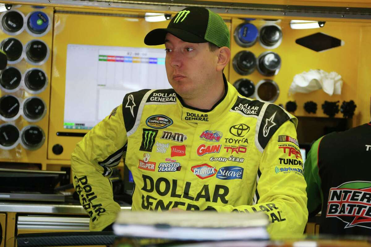 Kyle Busch waits in the garage before a practice session, Saturday, Aug. 15, 2015 for the NASCAR Sprint Cup series auto race at Michigan International Speedway, in Brooklyn, Mich. (AP Photo/Bob Brodbeck)