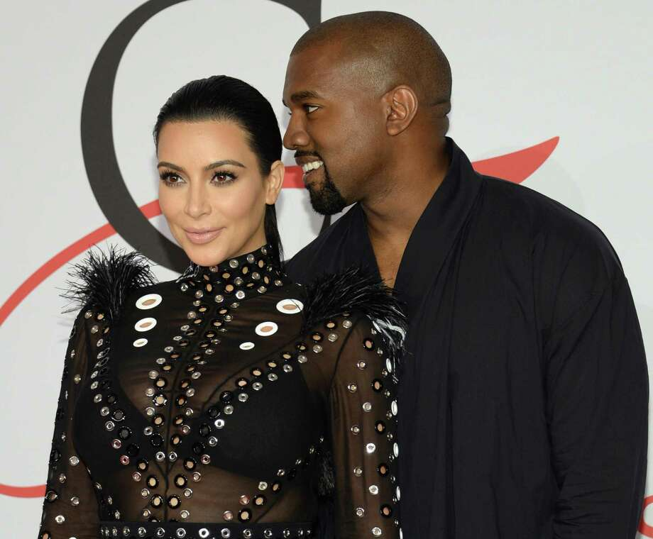 In this Monday, June 1, 2015, file photo, Kim Kardashian, left, and Kanye West arrive at the 2015 CFDA Fashion Awards at Alice Tully Hall, Lincoln Center, in New York. Kim Kardashian West and husband Kanye West welcomed a baby boy early Saturday, Dec. 5, 2015, in Los Angeles. This is the second child for the superstar couple: Daughter North was born in 2013. Photo: Photo By Evan Agostini/Invision/AP, File   / Invision
