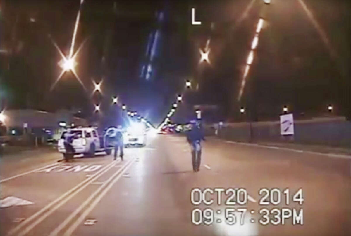 In this Oct. 20, 2014 frame from dash-cam video provided by the Chicago Police Department, Laquan McDonald, right, walks down the street moments before being shot by officer Jason Van Dyke in Chicago. Amid an outcry after the city waited more than a year to release dash-cam footage of Officer Van Dyke shooting McDonald 16 times, Mayor Rahm Emanuel announced this week that he was setting up a special task force to examine, among other things, the city's video-release policy.