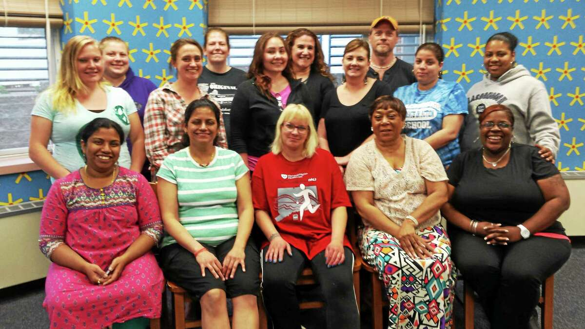 Members of Middletown's 2014 Parent Leadership Training Institute class are shown alongside Parents Supporting Educational Excellence. Both groups focuses on parent engagement for student success and school improvement strategies.