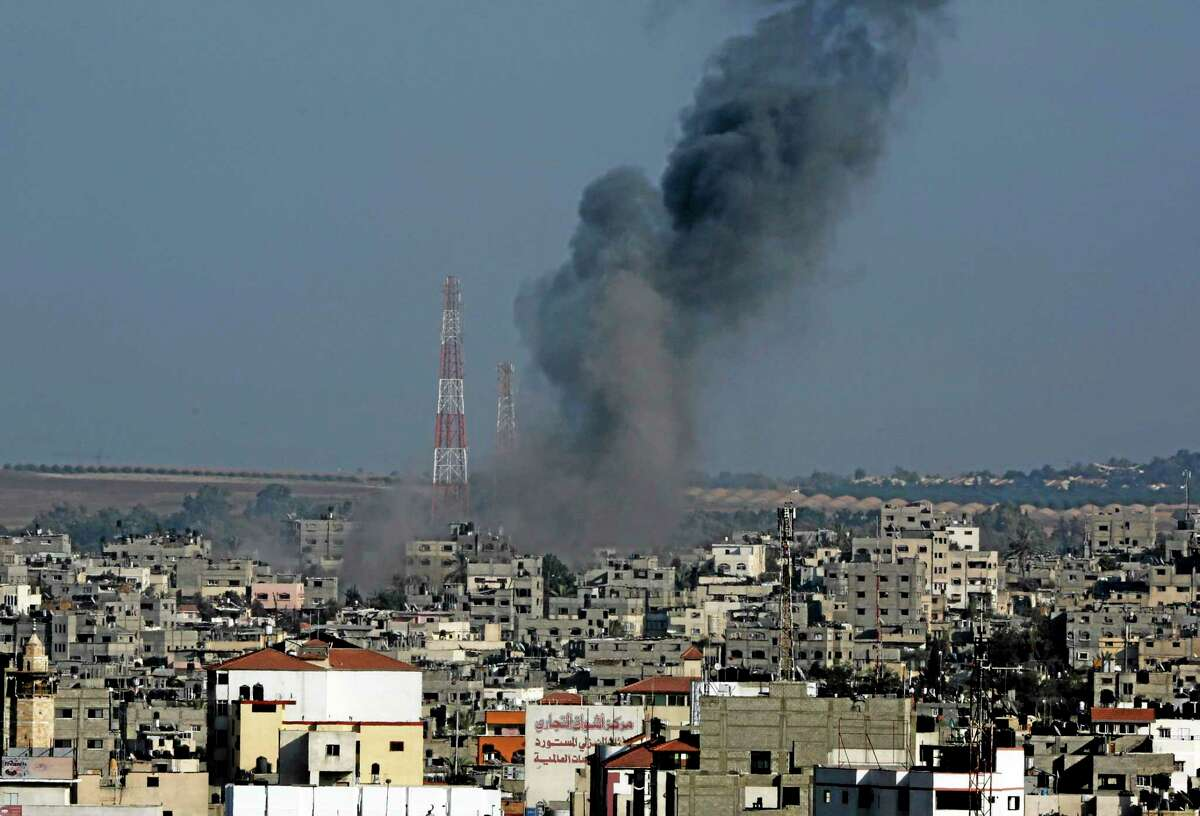 Smoke rises after an Israeli strike hit Gaza City in the northern Gaza Strip, Tuesday, Aug. 19, 2014. The Israeli military said it carried out a series of airstrikes Tuesday across the Gaza Strip in response to renewed rocket fire, a burst of violence that broke a temporary cease-fire and endangered negotiations in Egypt over ending the month long war between Israel and Hamas. The fighting occurred some eight hours before a temporary truce was set to expire.