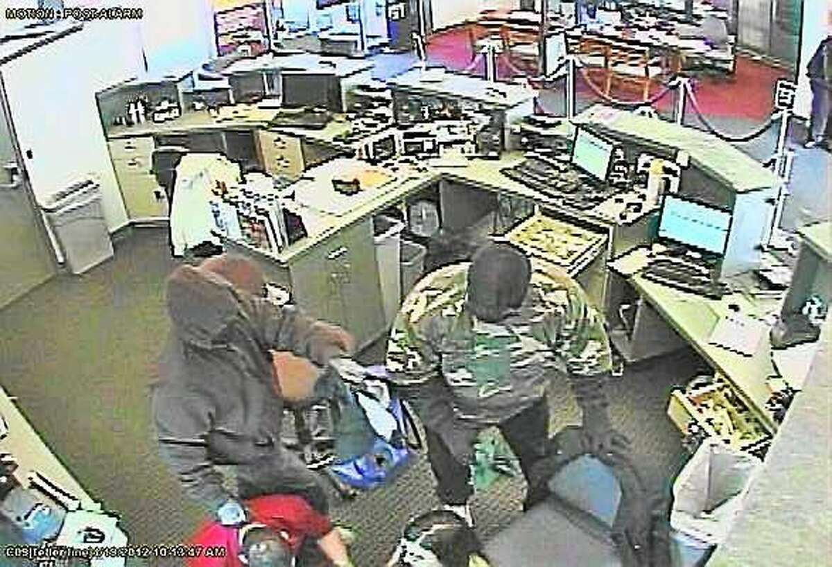 A surveillance image shows two robbers inside the Connex Credit Union in Wallingford in 2012.