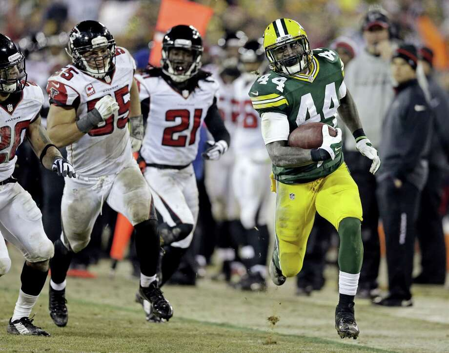 Green Bay Packers' James Starks (44) breaks away for a 41-yard run during the second half of an NFL football game against the Atlanta Falcons Monday, Dec. 8, 2014, in Green Bay, Wis. The Packers won 43-37. (AP Photo/Tom Lynn) Photo: AP / FR170717 AP