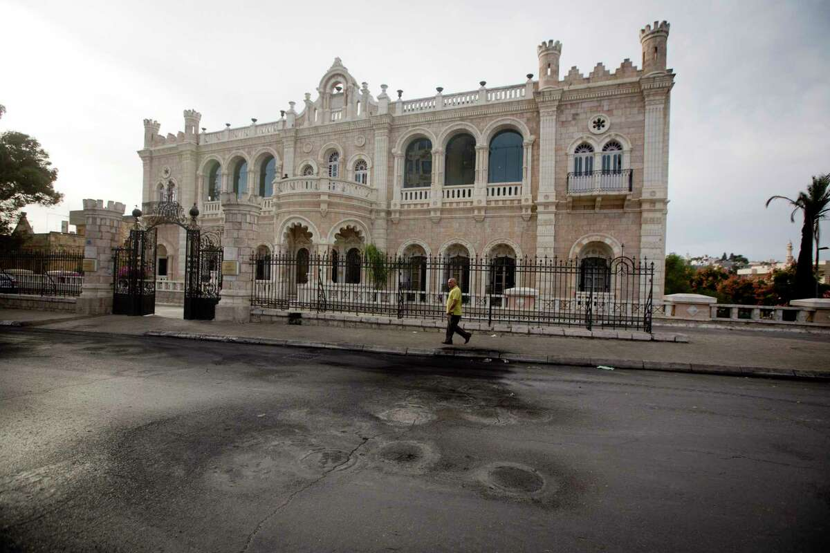 This Saturday, Nov. 28, 2015, photograph shows burnt tire marks in front of the Intercontinental hotel, in the West Bank town of Bethlehem. The century-old Jacir Palace hotel, with its soaring stone archways and wrought iron balconies, was once a symbol of Bethlehem's wealth and tourism potential. Today, the property reflects the city's dour mood ahead of the crucial Christmas season after months of unrest that has taken more than 100 lives, including a Palestinian waiter from the hotel.