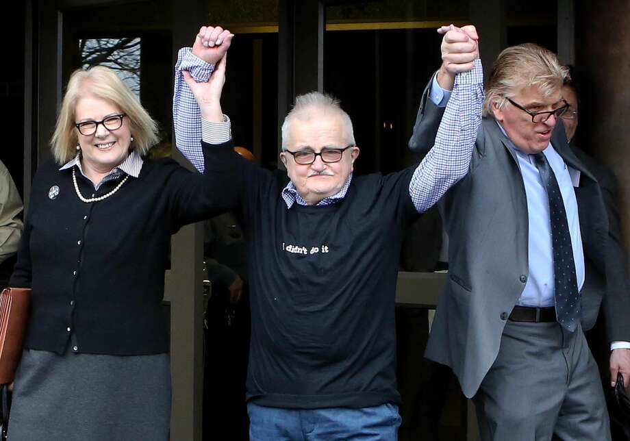Richard Lapointe, center, raises his arms with Kate Germond, left, Centurion Ministries Co-Director, and Paul Casteleiro, right, Centurion Ministries Legal Director, after he was granted bail and released Friday at the Connecticut Supreme Court in Hartford. Photo: Associated Press/Journal Inquirer, Jared Ramsdell  / Journal Inquirer