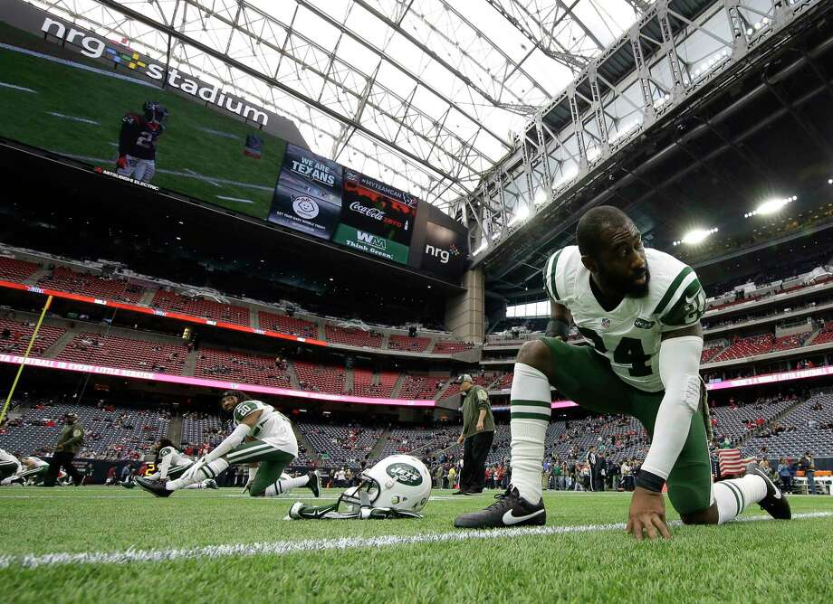New York Jets cornerback Darrelle Revis will miss Sunday's game against the Giants. Photo: David J. Phillip — The Associated Press  / AP