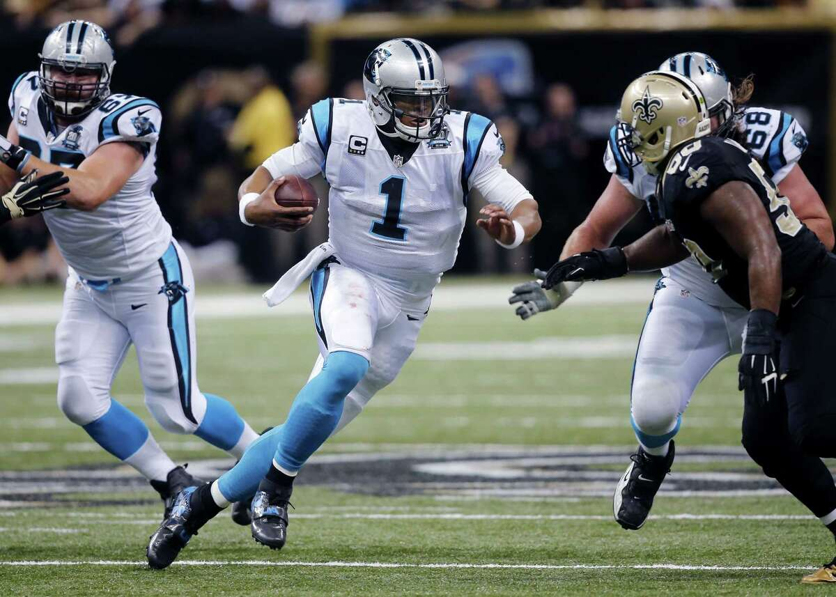 Carolina Panthers quarterback Cam Newton carries the ball in the first half of Sunday's win over the Saints in New Orleans.