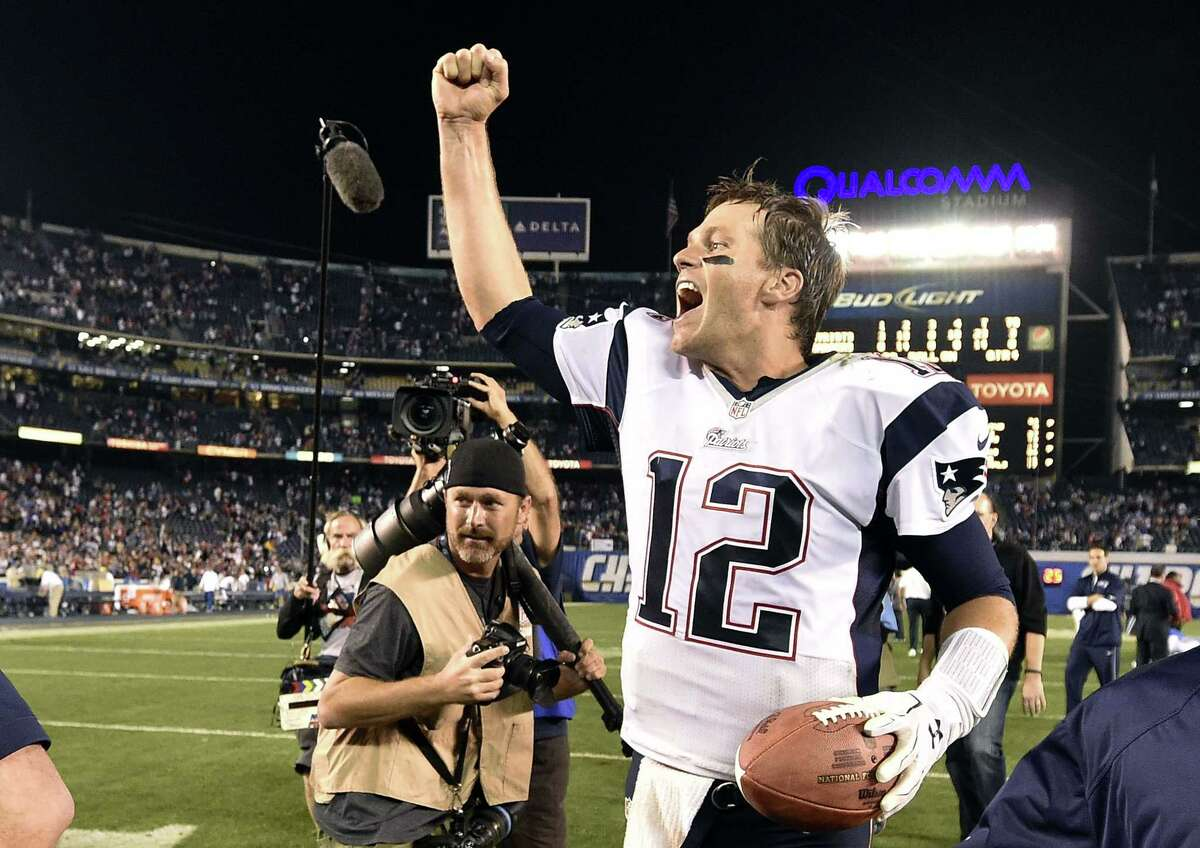 New England quarterback Tom Brady celebrates after the Patriots defeated the Chargers 23-14 on Sunday in San Diego.