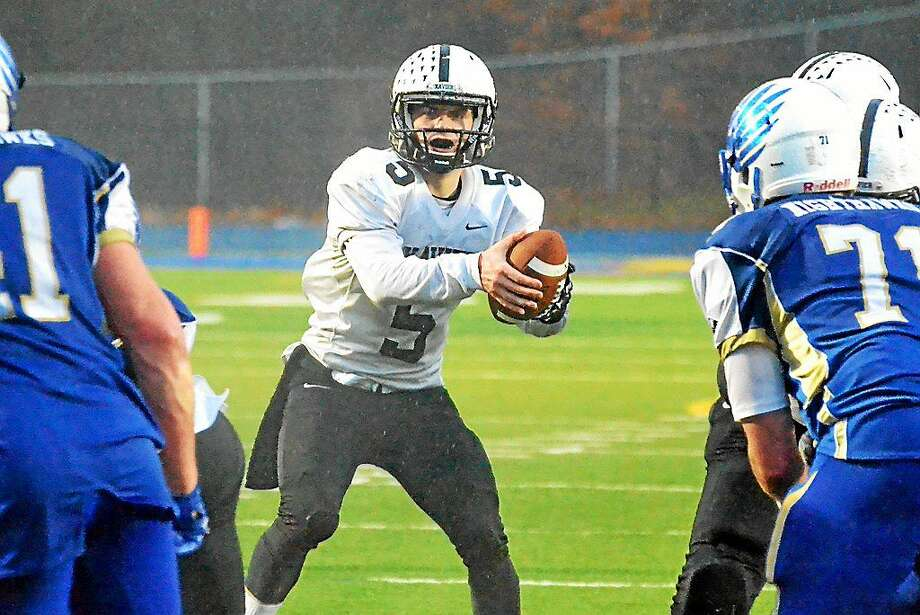Xavier quarterback Mike Scherer will meet Shelton in in the Class LL-Small state championship game on Saturday at West Haven High's Strong Stadium at 2:30 p.m. Photo: Pete Paguaga — New Haven Register