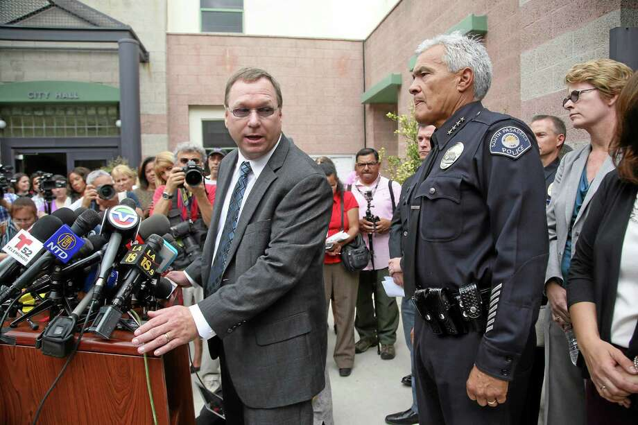 South Pasadena, Calif., police chief Arthur Miller, right, and South Pasadena Unified School District superintendent Dr. Geoff Yanz announce at a City Hall news conference Tuesday, Aug. 19, 2014, that the police has arrested two South Pasadena High School high school students suspected of planning a massacre at the school after investigators monitored their Internet activities. Miller said that school officials had heard about the plot and informed police, who determined the threat was credible. Police say the boys, ages 16 and 17, didn't have weapons but were researching automatic weapons and explosives, especially propane. (AP Photo/ Nick Ut ) Photo: AP / AP