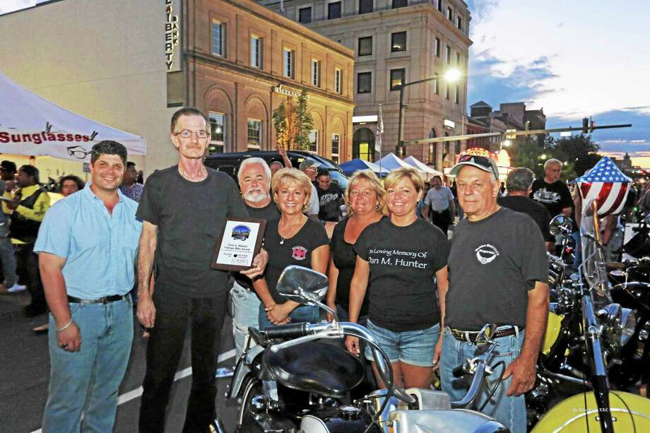 Mayor Dan Drew and members of the Hunter family pose with Bill Pinard of Manchester and his 1066 Harley FLH Electraglide at the 10th Annual Middletown Motorcycle Mania. Pinard was the winner of The Vern A. Hunter Vintage Bike Award, in Loving Memory of Vern and Barbara Hunter, presented by Hunter's Ambulance and Hunter Limousines. Photo: Courtesy Photo  / (c)DE KINE PHOTO LLC