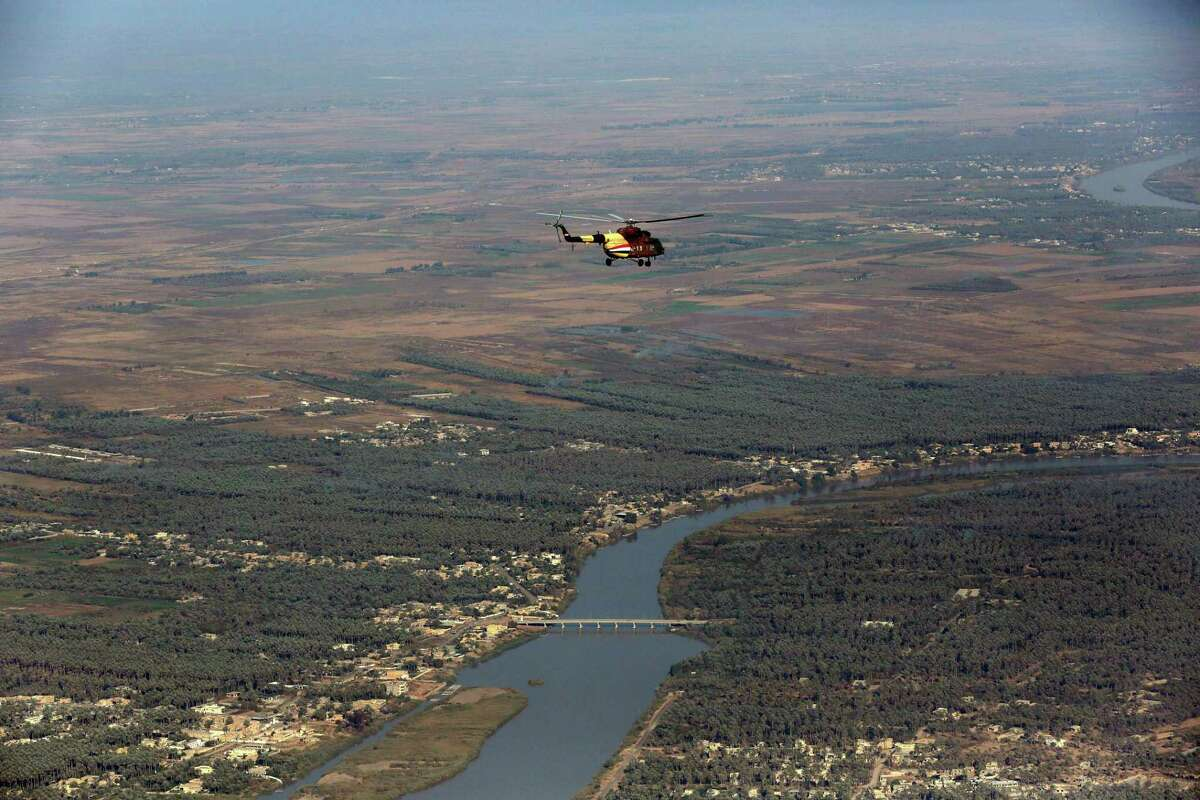An Iraqi Army helicopter flies over the city of Baquba, the capital of Iraq's Diyala province, 35 miles (60 kilometers) northeast of Baghdad, Iraq.