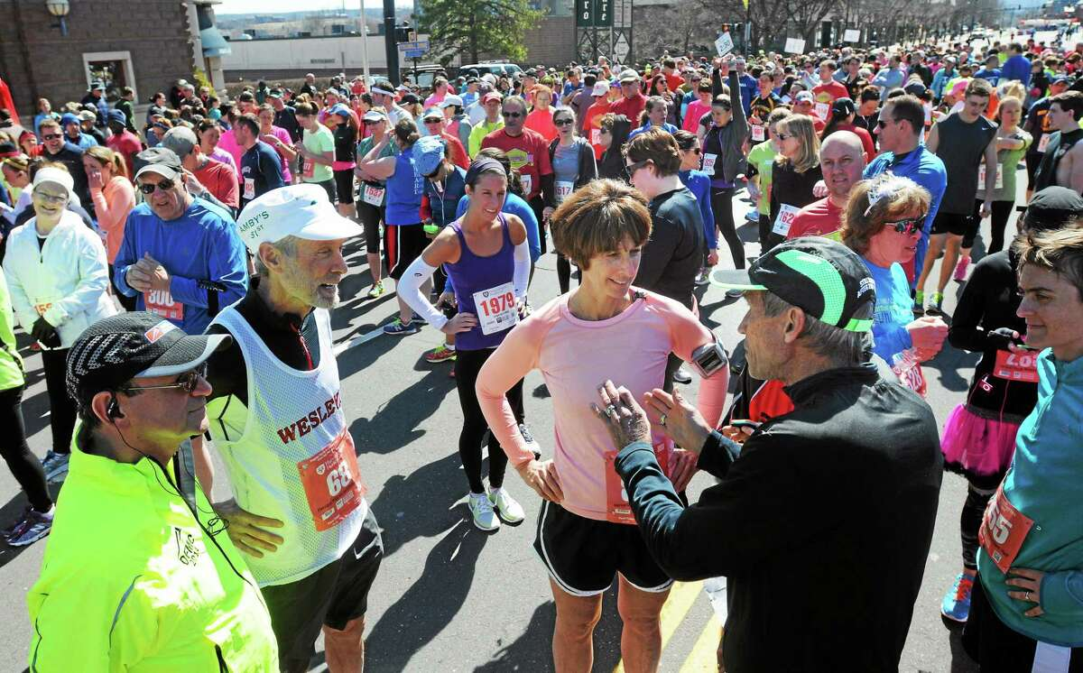 Harvard Pilgrim Half & Legends 4 Mile road race in Middletown in April 2014. Legendary runners Amby Burfoot, second from left, and Jeff Galloway, right, chat with racers before the start of the race.