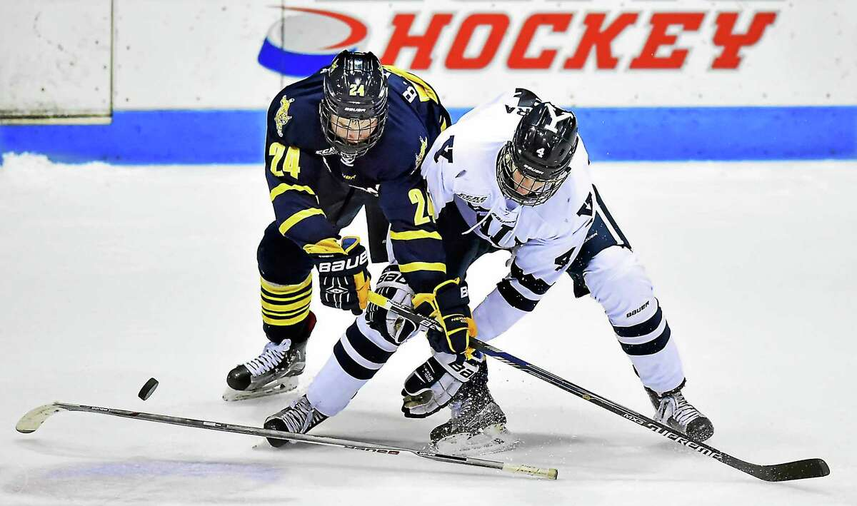 Quinnipiac's Bo Pieper collides with Yale's Rob O'Gara while in pursuit for a loose puck during Friday's game at Ingals Rink.