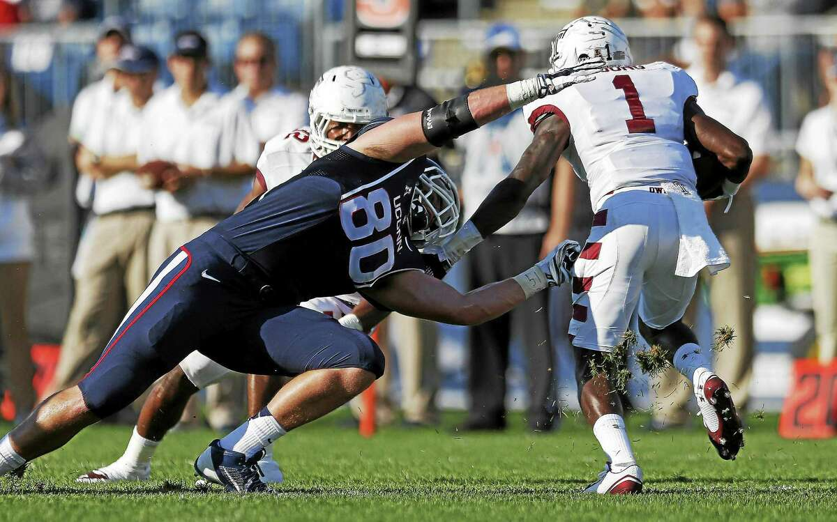 UConn tight end Tommy Myers, shown here trying to make a tackle after an interception against Temple last season, figures to see more playing time this season.