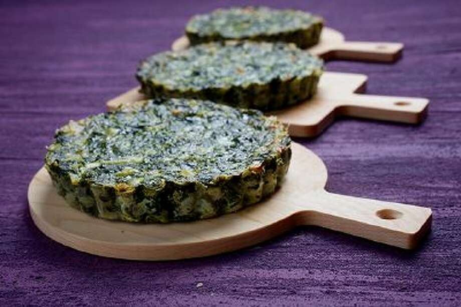 Spinach Pies are a quick and easy way to present good-for-you-greens as a side dish or light lunch. Illustrates FOOD-IRISH (category d), by Bonnie Benwick &Copy; 2014 The Washington Post. Moved Tuesday, March 11, 2014. (MUST CREDIT: Photo for The Washington Post by Deb Lindsey) Photo: The Washington Post / THE WASHINGTON POST