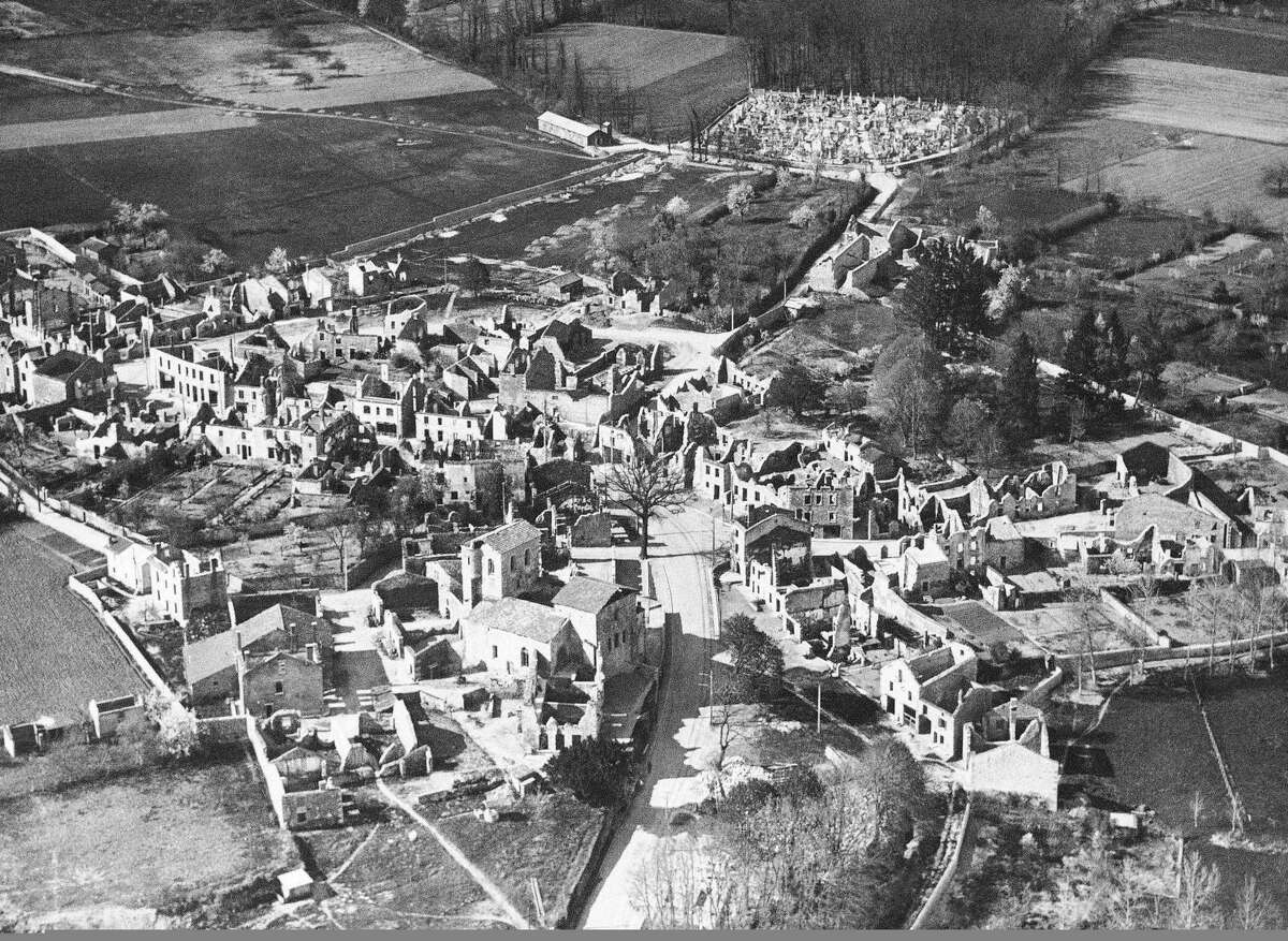 FILE - In this Jan. 1, 1953 b/w file picture, an aerial view of the destroyed Oradour-sur-Glane, in France is visible . A German court on Tuesday Dec. 9, 2014 threw out the case against a former SS man accused of involvement in the largest civilian massacre in Nazi-occupied France, saying there was not enough evidence to bring the 89-year-old to trial. Cologne resident Werner C., whose last name has not been revealed in accordance with German privacy laws, was charged with murder and accessory to murder in connection with the 1944 slaughter in Oradour-sur-Glane in southwestern France. (AP Photo,File)