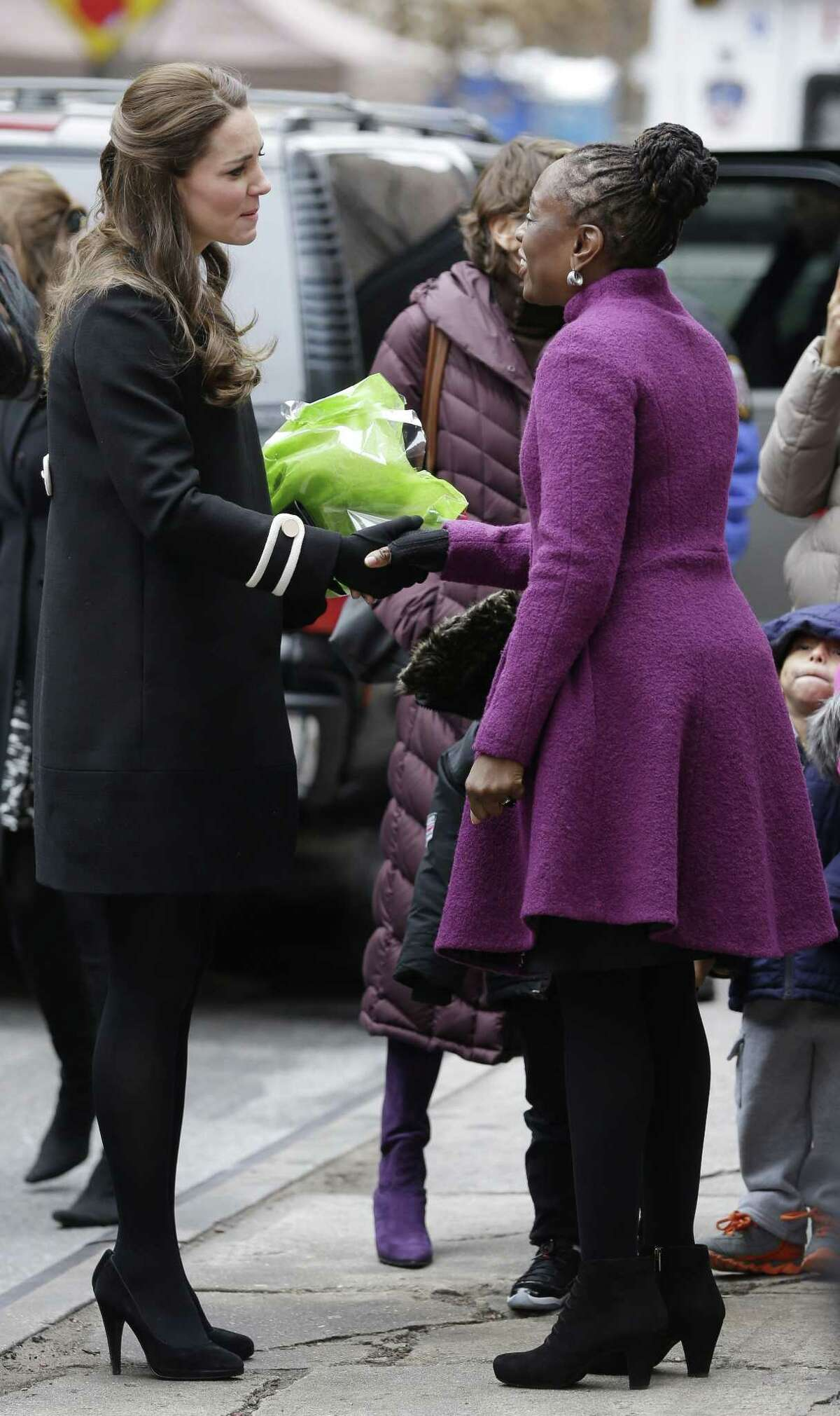 Kate Middleton, the Duchess of Cambridge, left, shakes hands with Chirlane McCray, wife of New York City Mayor Bill de Blasio, after leaving the Northside Center for Childhood Development in New York, Monday, Dec. 8, 2014. (AP Photo/Seth Wenig, Pool)