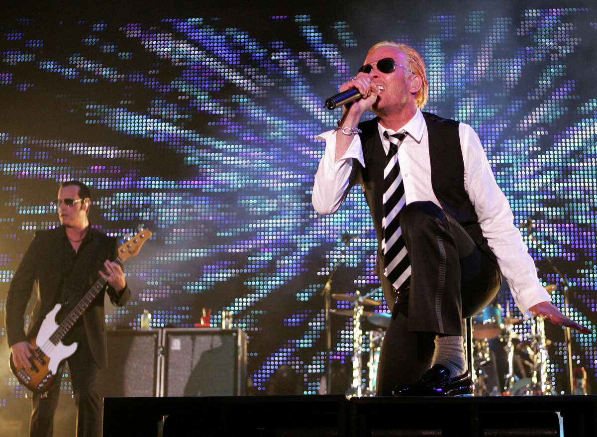 In this May 17, 2008, file photo, Scott Weiland, singer for the rock band Stone Temple Pilots, right, and bass player Robert DeLeo perform during their concert as part of Rock on the Range in Columbus, Ohio. Weiland, the former frontman for the Stone Temple Pilots and Velvet Revolver, has died. He was 48. The singer's manager confirmed the death to The Associated Press early Friday, Dec. 4, 2015.