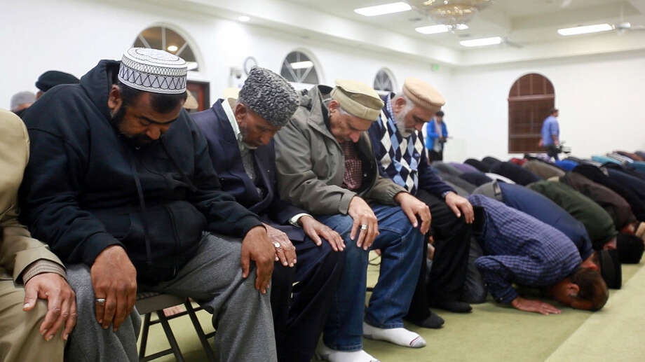 At Baitul Hameed Mosque in Chino, Calif., the Los Angeles chapter of Ahmadiyya Muslim Community hold a vigil for shooting victims Thursday, Dec. 3, 2015. A husband and wife opened fire on a holiday banquet, killing multiple people Wednesday in San Bernardino. Hours later, the couple died in a shootout with police. Photo: Yihyun Jeong/The Arizona Republic Via AP   / The Arizona Republic