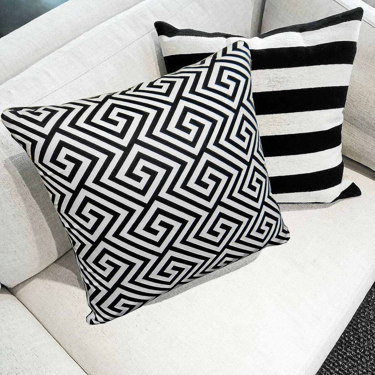 Black and white M Cushions on a sofa