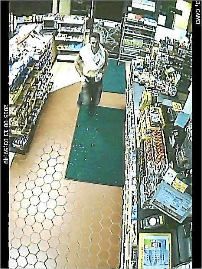 Police are asking for the public's help to identify this man, who they say burglarized a Middletown gas station Thursday. Photo: Middletown Police Department