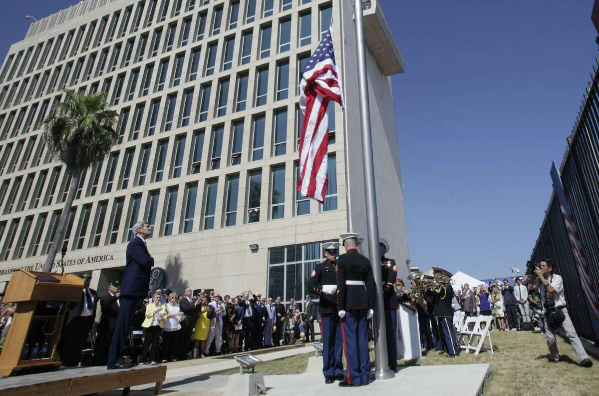 U.S. Secretary of State John Kerry watches the raising of the American flag Friday at the newly opened U.S. Embassy in Havana, Cuba. Kerry presided Friday over the flag raising ceremony in Havana as the United States and Cuba re-establish diplomatic relations after more than 54 years.
