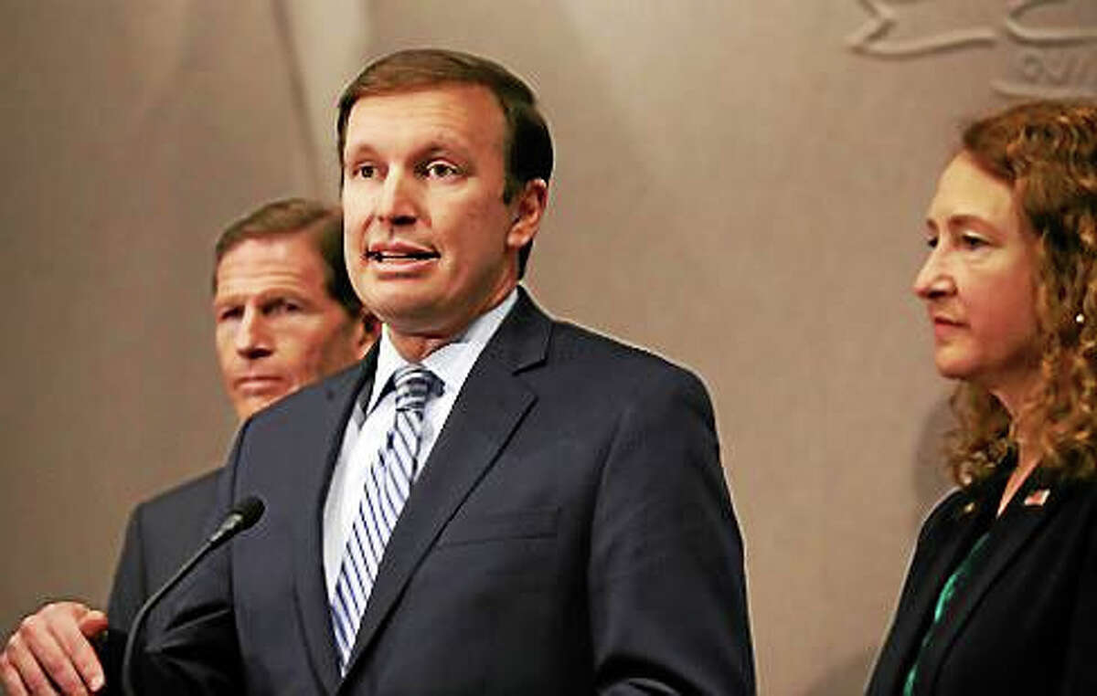 U.S. Sen. Chris Murphy flanked by U.S. Sen Richard Blumenthal and U.S. Rep. Elizabeth Esty