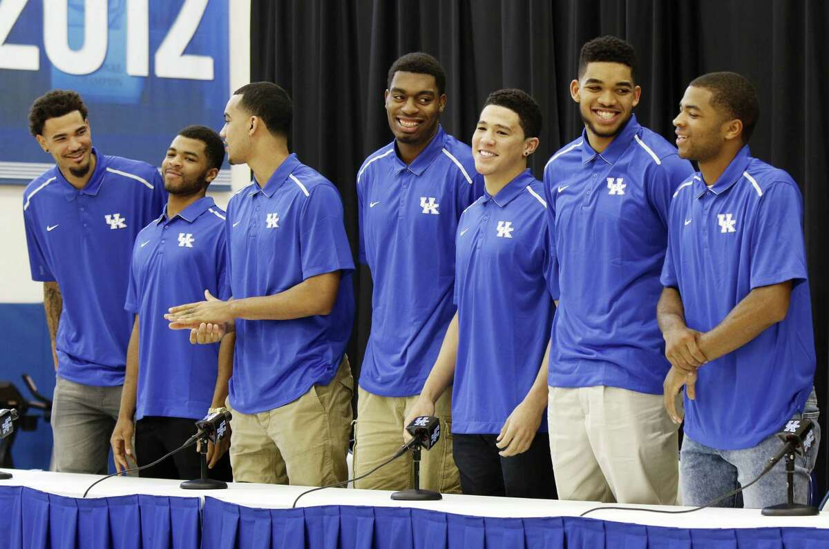 From left, Kentucky players Willie Cauley-Stein, Andrew Harrison, Trey Lyles, Dakari Johnson, Devon Booker, Karl-Anthony Towns and Aaron Harrison stand during a news conference where they announced their intent to enter the NBA Draft on Thursday in Lexington, Ky.
