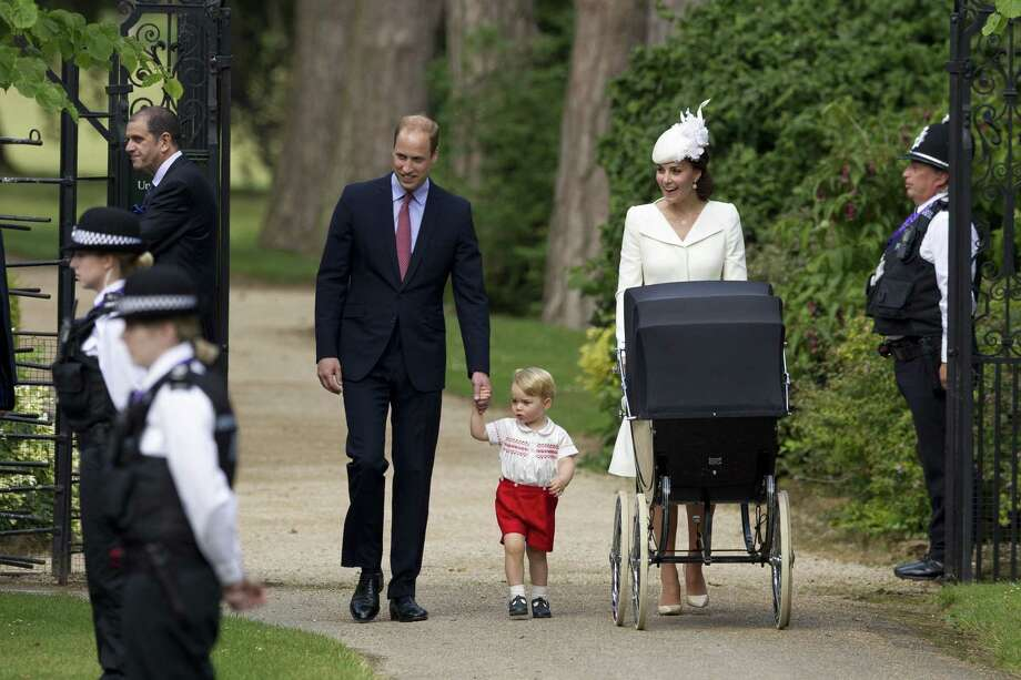 FILE- In this file photo dated Sunday, July 5, 2015, Britain's Prince William, Kate the Duchess of Cambridge, their son Prince George walk with their daughter Princess Charlotte in a pram, during an official media event as they arrive for Charlotte's Christening at St. Mary Magdalene Church in Sandringham, England.  Royal officials at Kensington Palace are urging all media organizations not to publish images of Prince George and Princess Charlotte, by some paparazzi photographers who are using increasingly dangerous tactics to snap images of the royals, which presents a risk ìin a heightened security environment.íí (AP Photo/Matt Dunham, FILE) Photo: AP / AP POOL