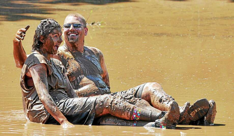 Zoar's Pond is the setting Saturday for the 29th annual mud volleyball tournament sponsored by the Epilepsy Foundation of Connecticut on Randolph Road in Middletown. Photo: Press File Photo  / TheMiddletownPress