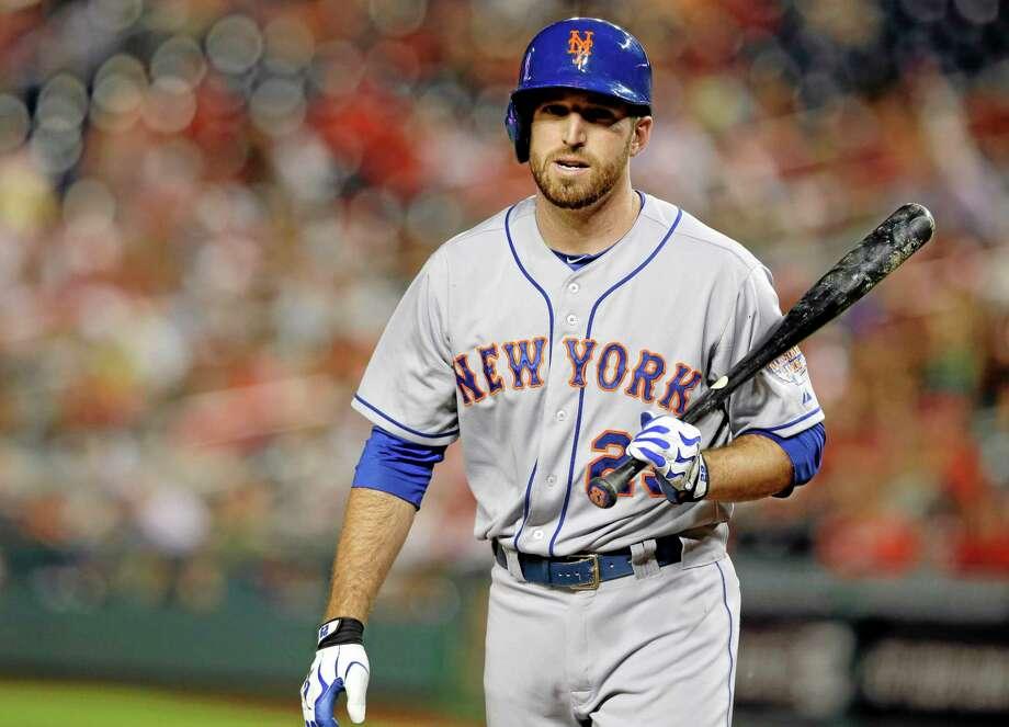 New York Mets first baseman Ike Davis was wearing a walking boot on his right leg on Monday. Photo: Alex Brandon — The Associated Press  / AP