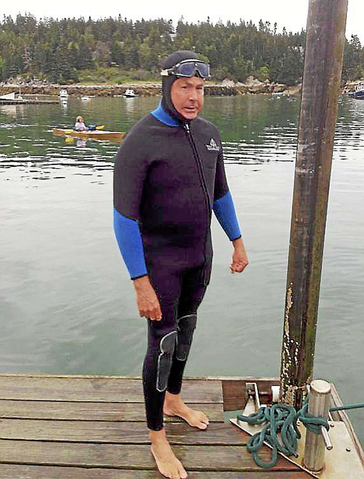Fred Brooke swam the bone-chilling waters off the northernmost coast of Maine in July this summer.
