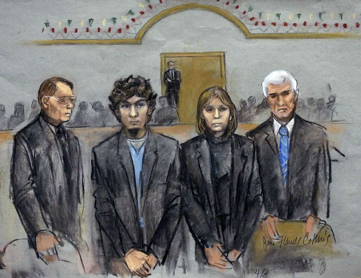 In this courtroom sketch, Dzhokhar Tsarnaev, second from left, is depicted standing with his defense attorneys as the jury presents its verdict in his federal death penalty trial Wednesday, April 8, 2015, in Boston.