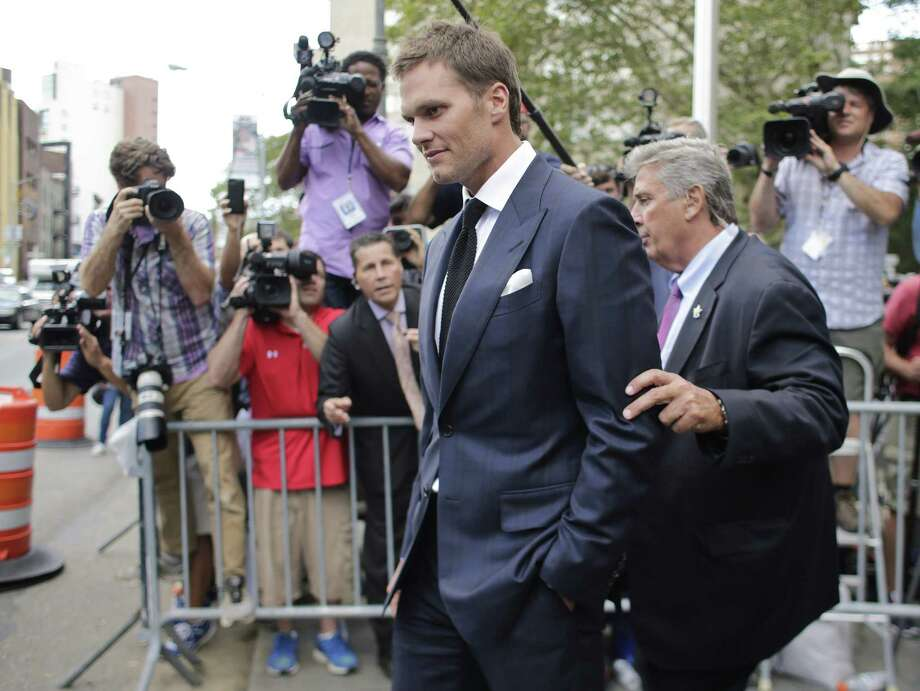 New England Patriots quarterback Tom Brady leaves federal court Wednesday. Brady left the courthouse after a full day of talks with a federal judge in his dispute with the NFL over a four-game suspension. Photo: Frank Franklin II — The Associated Press  / AP