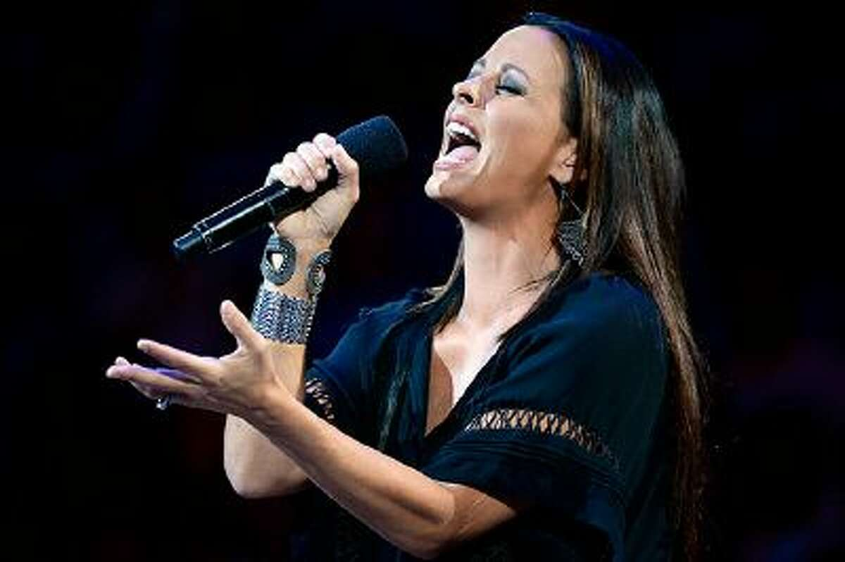 OKLAHOMA CITY, OK - JUNE 14: Singer Sara Evans performs the national anthem before the Miami Heat take on the Oklahoma City Thunder in Game Two of the 2012 NBA Finals at Chesapeake Energy Arena on June 14, 2012 in Oklahoma City, Oklahoma. NOTE TO USER: User expressly acknowledges and agrees that, by downloading and or using this photograph, User is consenting to the terms and conditions of the Getty Images License Agreement. (Photo by Ronald Martinez/Getty Images)
