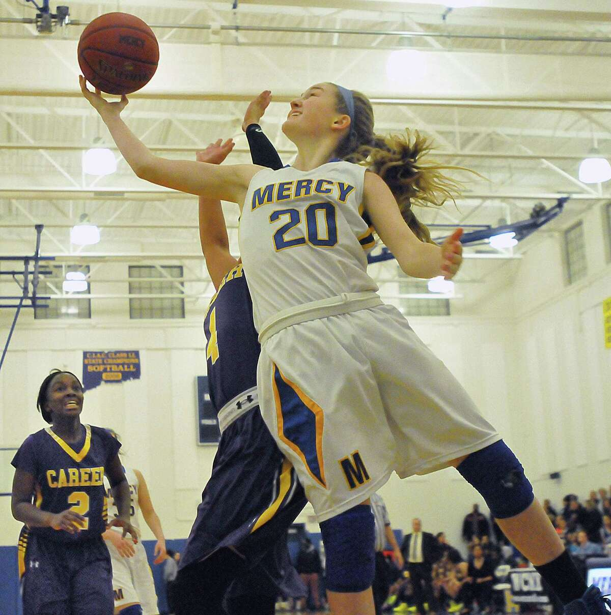 Mercy's Kendra Landy elevates for a shot as Career Magnet's Ashley Arroyo defends during a game last season.