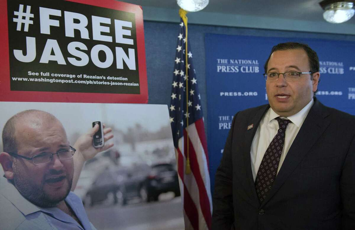 Ali Rezaian, brother of Jason Rezaian, The Washington Post's Tehran bureau chief who is currently imprisoned in Iran, talks about the photo of his brother at a news conference at the National Press Club during update on the case in Washington July 22.