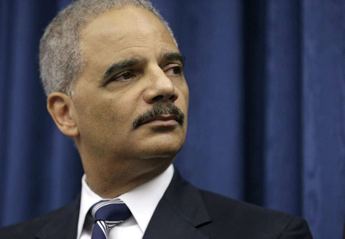 In this Dec. 4, 2014 photo, U. S. Attorney General Eric Holder speaks during a news conference before a roundtable meeting in Cleveland.