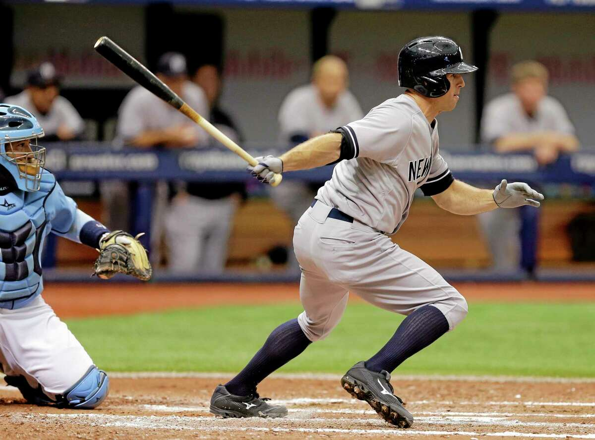 The Yankees' Brett Gardner lines a two-run single in the fifth inning Sunday.