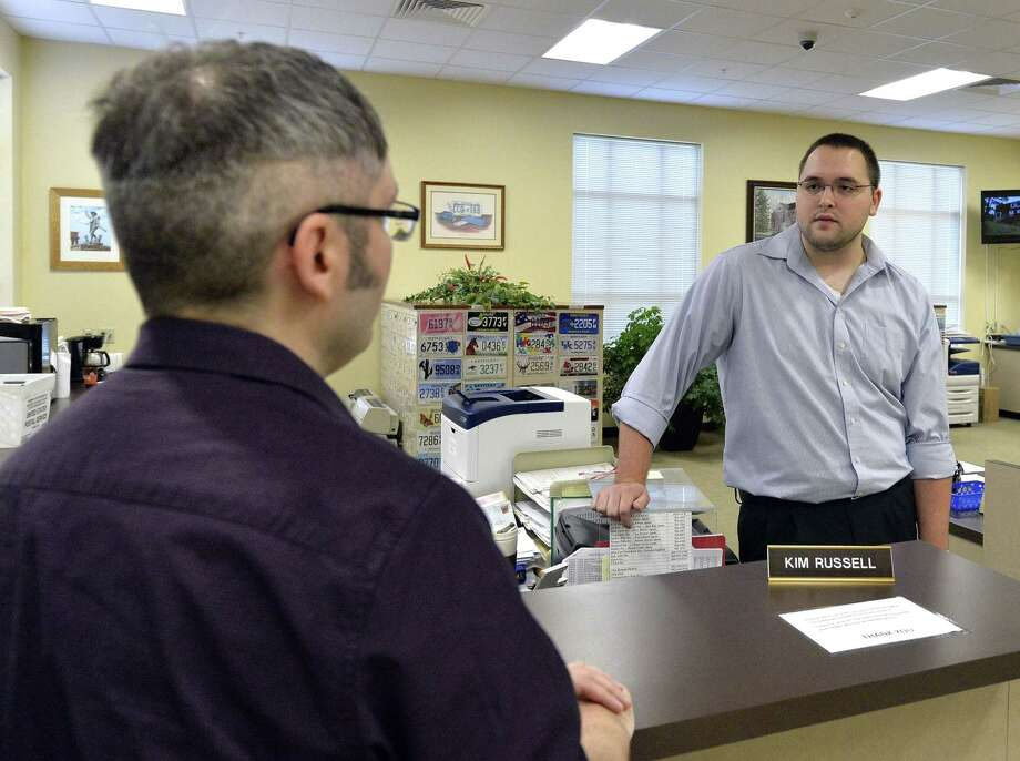 Rowan County clerk Nathan Davis, right, informs David Moore that the clerk's office will not be issuing any marriage licenses, in defiance of an order from a federal judge in Morehead, Ky. on Aug. 13, 2015. Rowan County Clerk Kim Davis has already filed a notice of appeal and plans to request a stay on the ruling. Photo: AP Photo/Timothy D. Easley  / FR43398 AP