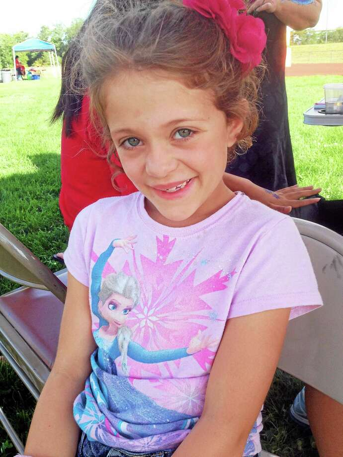 The Portland Unified Sports program is partially funded by a grant from Dylan's Wings of Change, a foundation begun by the parents of Dylan Hockley, one of the 20 young victims of the 2012 Sandy Hook massacre. Here, children enjoy face painting and the festivities during the community celebration Aug. 12. Photo: Jeff Mill — The Middletown Press